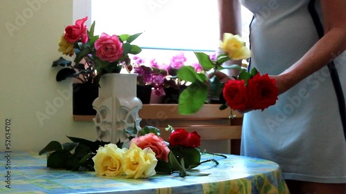 Women arranging flowers in vase
