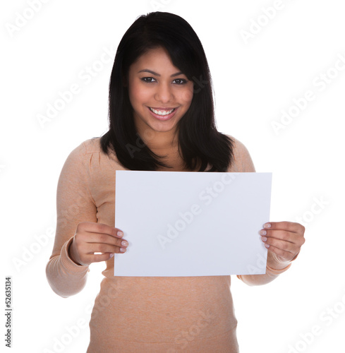 Young Woman Pointing At Placard