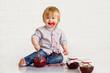 Adorable little boy got messy eating strawberry jam