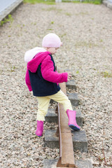 little girl at out of action track on Laigh Milton Viaduct, East