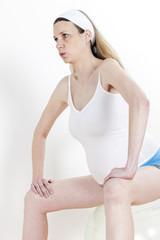 portrait of pregnant woman doing exercises