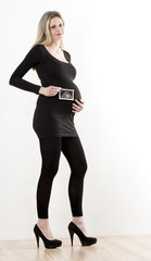 pregnant woman with a sonogram of her baby