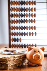 Piggy bank on old book