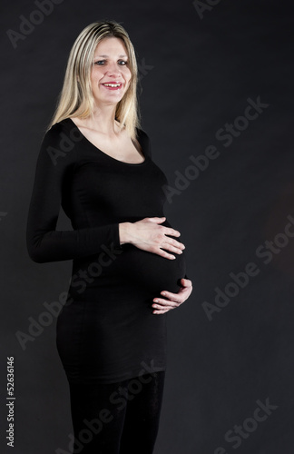 portrait of pregnant woman wearing black clothes