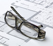 glasses of architect on drawing board