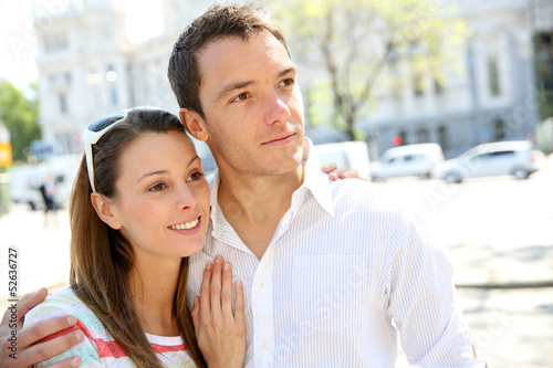 Sweet couple walking in city avenue