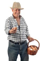 farmer man holds a basket with eggs