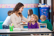 Little Girl Looking At Kindergarten Teacher