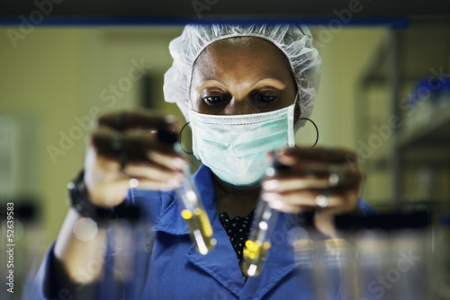 Industrial lab and staff, woman at work as scientist