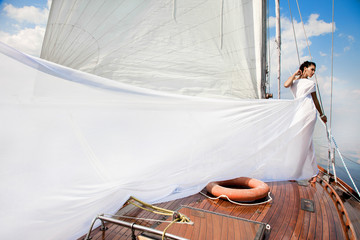 Girl on a yacht in the summer