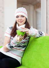 woman warms with cup of tea
