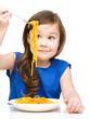 Little girl is eating spaghetti