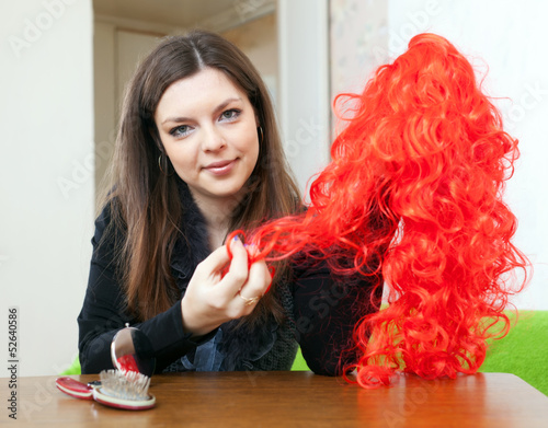 brunette woman with red false hair