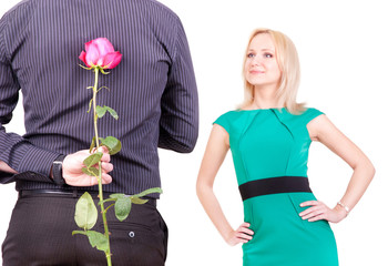 loving couple - man with rose surprise for his woman