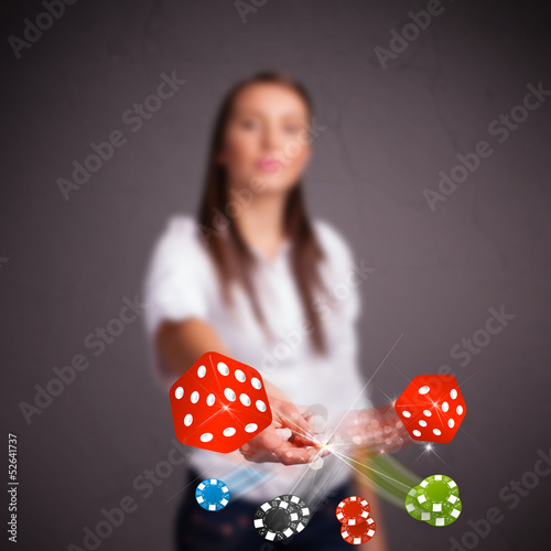 Young woman throwing dices and chips