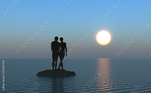 Young couple at the beach watching the moonrise