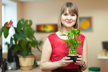 woman with  bamboo plant