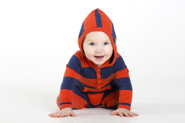 Charming baby boy in studio with hood