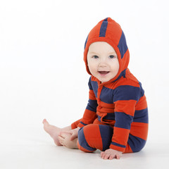 Charming baby boy sitting in studio with hood