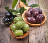 Fresh olives on wooden ground