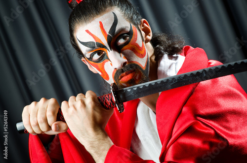Man with sword and face mask