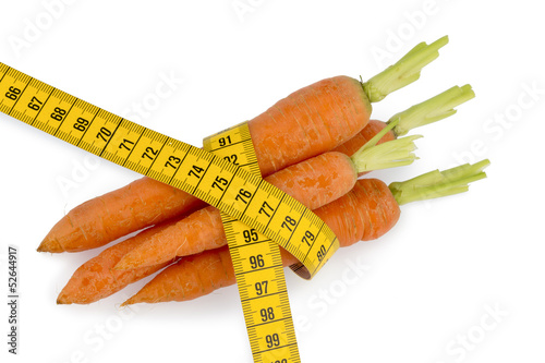 fresh carrots with tape measure
