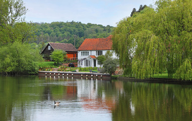 Riverside house and garden on the River Thames in England