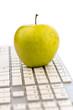 apple lies on a keyboard