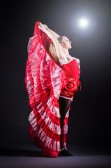 Girl in red dress dancing dance