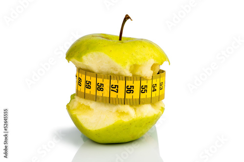 apple with measuring tape on