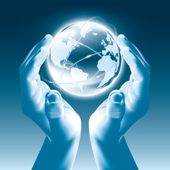 Holding a glowing earth globe in hands - Globalism