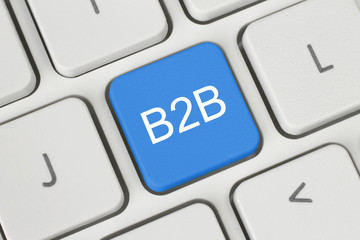 Blue B2B (business to business) button on keyboard close-up .