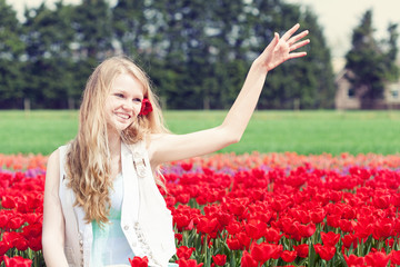 woman in a red tulip field