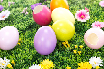 Some colorful Easter eggs on a blooming meadow