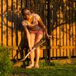 Pretty female gardener taking care of her lovely garden on a lov