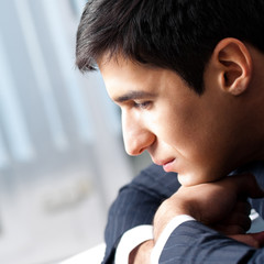 Thinking businessman at office