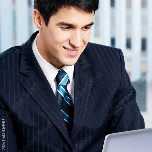 Businessman working with laptop at office