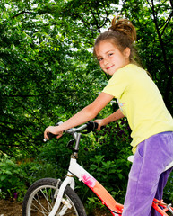 beautiful little girl on a bicycle