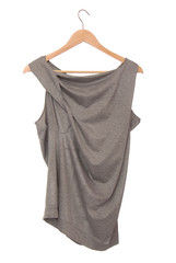 Grey blouse is on hanger.