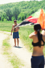 Happy couple flying a kite