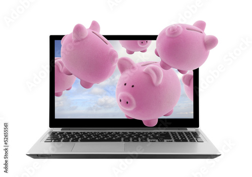 Laptop and piggy banks isolated on white