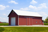 Red Barn With White Garage Door