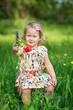 Cute little girl in a meadow full of flowers