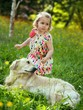 Child and golden retriever