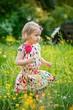 Cute little girl in the garden