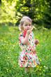 Portrait of a little girl with a lollipop