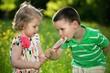 Children and a big lollipop
