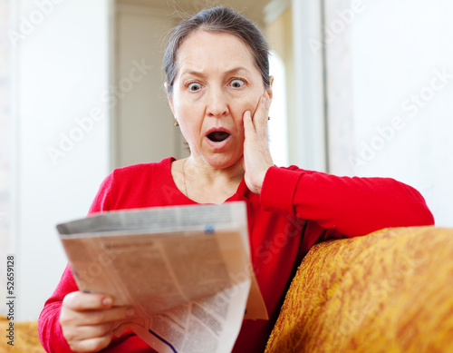 fright  woman with newspaper