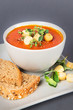 A bowl with Tomato Soup with Croutons and Herbs