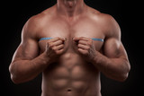 bodybuilder with a measuring tape around his chest poster